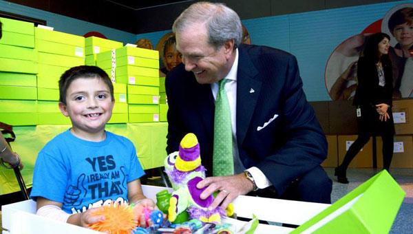 Bill Horton, Regions Financial Area President, distributing Cheeriodicals at Children's of Alabama in Birmingham. (contributed)