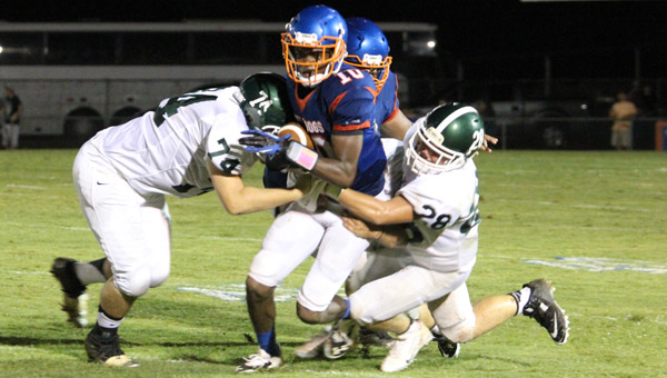 Montevallo's Keondre Bailey tries to break free of a Locust Fork tackle in a 47-0 loss Aug. 22. (Contributed/Amy Pintaro)