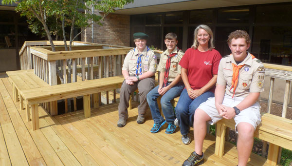Three Boy Scout Eagle candidates of Troop 588 of Wilsonville completed Eagle projects at Elvin Hill Elementary School. From left, Wil Langner; Johnathan Langner; EHES Principal Betsy Smith and Corbin Hillman. (Contributed)