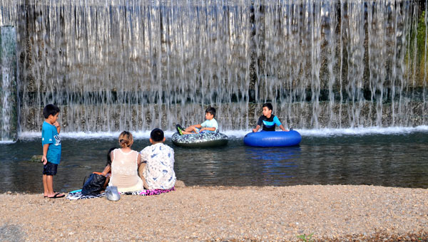 The island near the Buck Creek dam waterfall is a popular summer attraction in Helena. (Contributed)