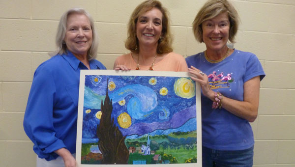 Judy Elliott, Columbiana Public Library Director Dutcha Lawson and Karen Jenson hold a copy of Vincent van Gogh's painting Starry Night that will be the focus of a painting workshop August 21, 2014, at the library during the adult summer reading program. (Contributed)