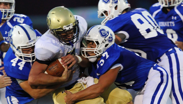 Chelsea's Joey Chiofalo wraps up Briarwood quarterback Walker Lott in a 23-22 win on Aug. 29. (Contributed/Cari Dean)