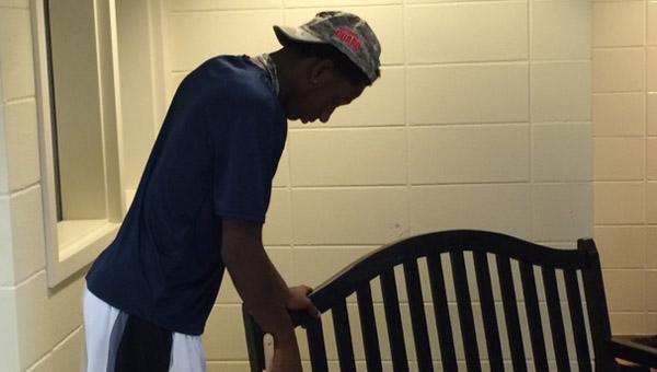 A Thompson football player works to repaint a bench at Creek View Elementary on Aug. 23. (Contributed)