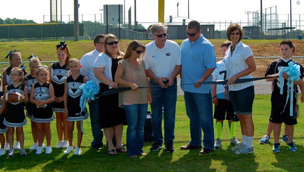 Helena Mayor Mark Hall cut the ribbon on the new youth football field at the Helena Sports Complex durin gan Aug. 9 ceremony. (Reporter Photo / Molly Davidson)
