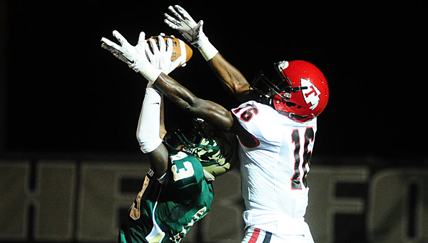 Pelham's Jeremy Ross comes down with a pass in the end zone intended for Thompson's Patrick Haywood. (Reporter Photo/Jon Goering)