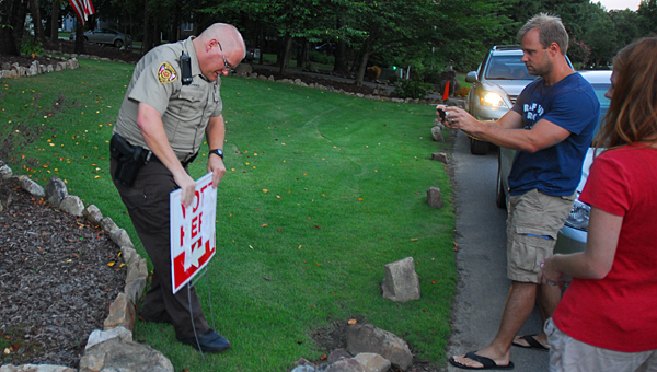 A Shelby County Sheriff's Office deputy posts the results of a July 29 election in Saddle Lake Farms. The neighborhood will now be served by the Alabaster Police Department. (Reporter Photo/Neal Wagner)