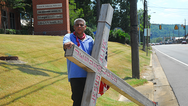 Art Robles walked through Shelby County toting an about 100-pound cross on Aug. 16 en route to Washington, D.C., to pray with President Barack Obama. (Reporter Photo/Neal Wagner)