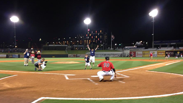 Gabe Griffin throws the first pitch at a Birmingham Barons game at Regions Field on Aug. 8. (Contributed)