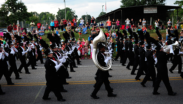 The Thompson High School band marches past thousands of spectators during Alabaster's 2013 homecoming parade. (File)