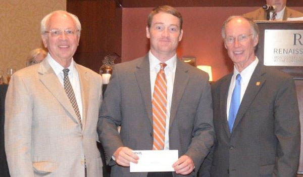 Governor Robert Bentley presented the award to Montevallo High School Assistant Principal Kevin Raybon and Principal Wesley Hester. (Contributed)