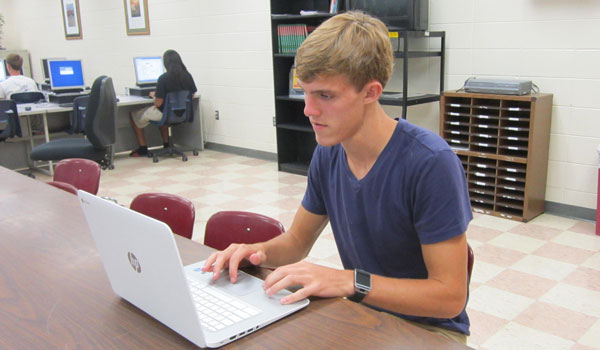 Roberts works on coding problems using the Chromebook, which each student in the CodeHS will receive to use for the course. (Reporter Photo / Ginny Cooper McCarley)