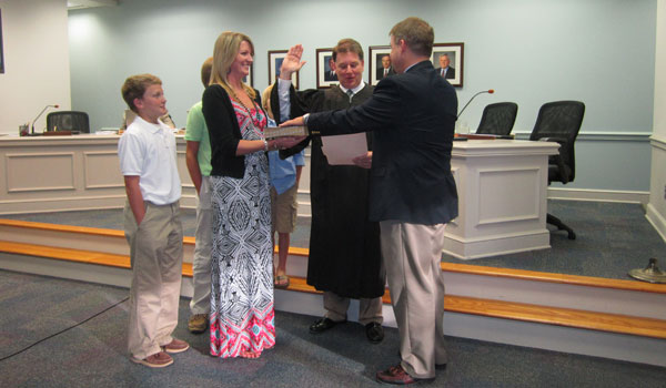 Kevin Morris, pictured with his wife and three children, is sworn in as interim board member for the Shelby County Board of Education. (Reporter Photo / Ginny Cooper McCarley)