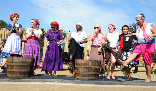 Contestants in the Lucy-Look-A-Like contest pose at the annual Morgan Creek Winery grape stomp. (File)