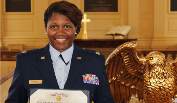 Lt. Col. Patricia Thomas holds a certificate after being awarded the USAF Defense Meritorious Service Medal. (Contributed)