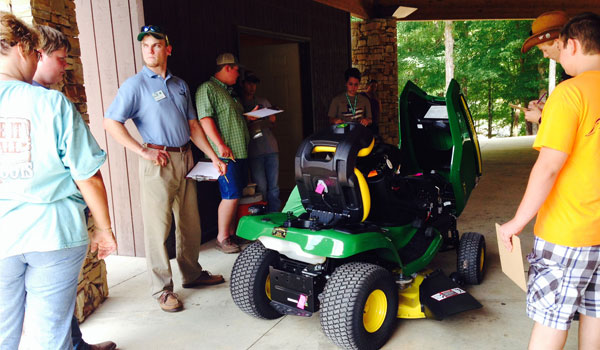 Students identify tractor parts during the lawn tractor competition. (Reporter Photo/Ginny Cooper McCarley)