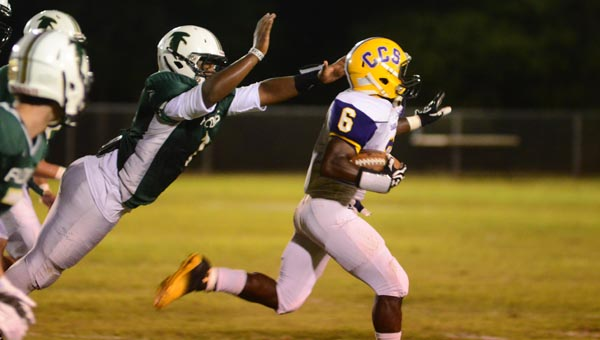 Cornerstone's Quartez Walker slips out of a defender's grasp in a 33-13 win over Ashford Sept. 26. (Reporter Photo/Drew Granthum)