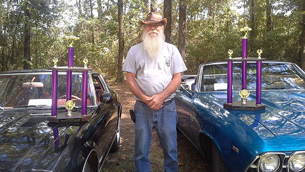 Howard Stamps poses for a picture with his two prize winning cars. A 1969 Chevelle and a 280 ZX Datsun. CONTRIBUTED