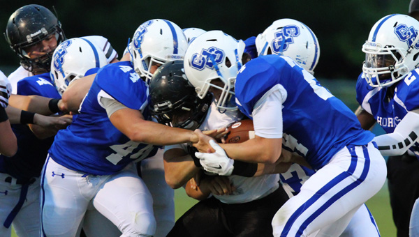 A swarm of Chelsea defenders bring down a Southside running back in a Sept. 5 matchup. (Contributed/Cari Dean)