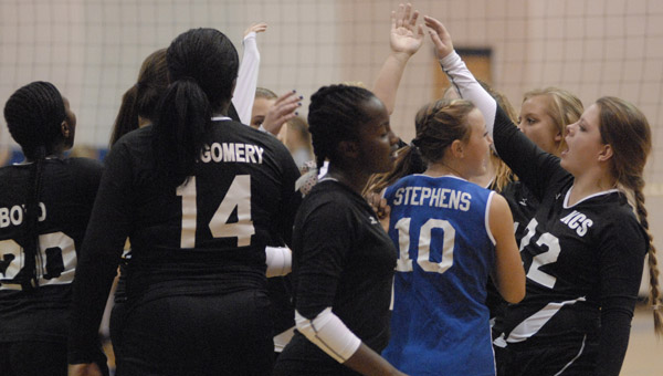 Members of Kingwood Christian's volleyball squad celebrate a win over Bessemer Academy on Sept. 2. (Reporter Photo/Drew Granthum)