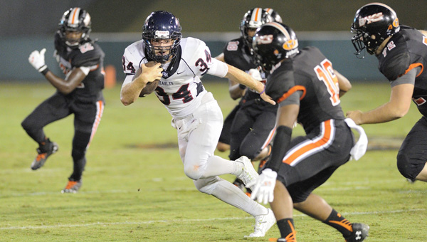 Oak Mountain running back Harold Shader runs through the Hoover defense in a Sept. 12 matchup. (Contributed/Barry Clemmons)