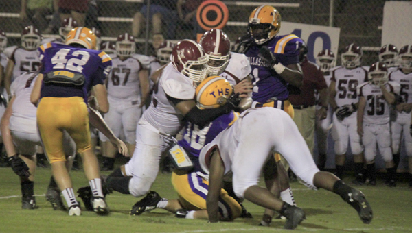 A trio of Shelby County defender converge on Tallassee running back Brandon Baynes. (Griffin Pritchard/Special to the Reporter)
