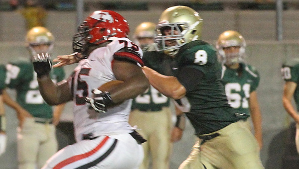 Thompson's T.J. Rayam returns an interception against Mountain Brook on Sept. 12. (Contributed/Eric Starling)