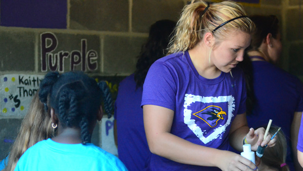 "Members of the Unversity of Montevallo's softball team help the Montevallo Boys and Girls Club paint at the ""Leave Your Mark on Orr Park"" event Sept. 23. (Reporter Photo/Drew Granthum)"