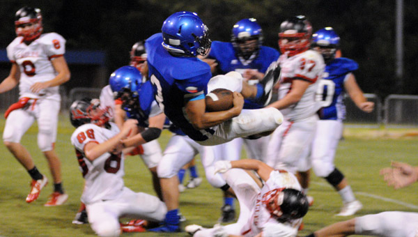 Kingwood's Chase Inabinett leaps for a touchdown in a 28-7 win over Jackson Academy on Sept. 19. (Contributed/Diane Cunningham)