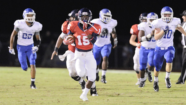 Oak Mountain's Evan Bennison breaks away from the defense in a 27-6 win over Tuscaloosa County on Sept. 19. (Contributed/Barry W. Clemmons)