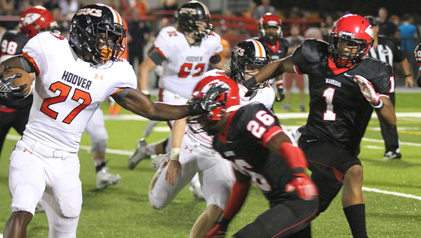 Thompson's Derrick Shaw (No. 1) looks to tackle Hoover's Bradrick Shaw in a Sept. 19 matchup. (Contributed/Eric Starling)