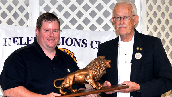 Wayne Dunlap from Alabama Zone 3, a 37-year member of Lions Club, presents President Emmanuel Scozzaro with the official club mascot statue. (Contributed)