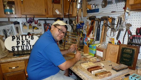 Phil Morris in his studio workshop, where he makes his award-winning pens. (Contributed)