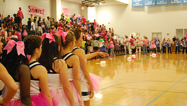 """Calera High School students and faculty participated in the city wide """"Paint the town pink."""" CHS Cheerleaders prepare to get student's fired up during a Friday pep rally. (Reporter Photo/Graham Brooks)"""