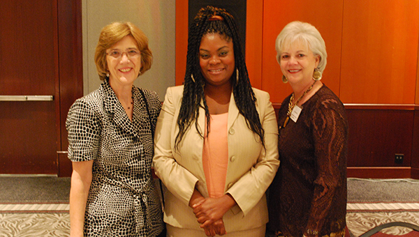 From left to right: Diane Cesario, Kamaria Givner and Kay Moore all pose for a photo at the Harvest for Hope luncheon on Sept. 16.