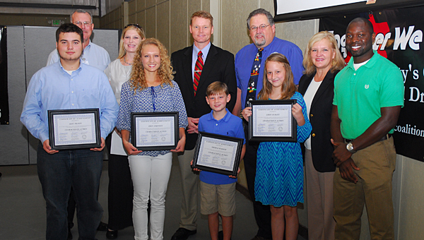 Character in Action Award winners, front row from left, Alex Tilton, Erin Atkinson, Thomas Washer and Libbey Dudley join Shelby County Drug Free Coalition members during a Sept. 18 meeting. (Reporter Photo/Neal Wagner)