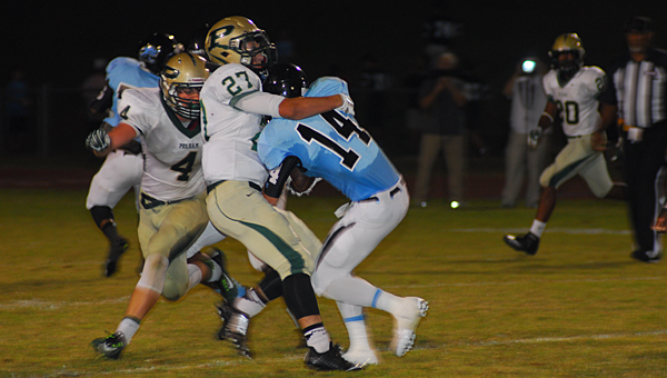 Pelham's Devin Jenkins (27) and Connor Christian (4) take down a Northridge player during the Panthers' 38-0 loss to the Jaguars on Sept. 26. (Reporter Photo/Neal Wagner)