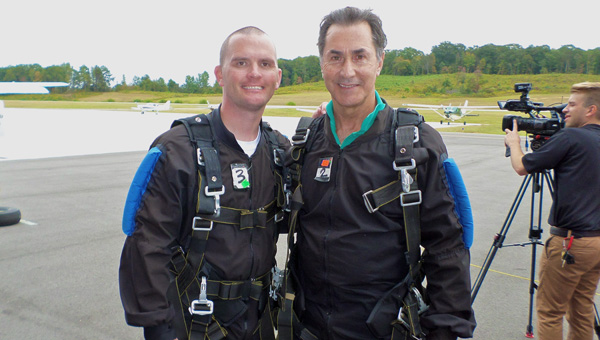 Dustin Chandler and Gary Palmer return after jumping out of a plane during the Sept. 27 Skydive 4 CDKL5 Research event at Skydive Alabama. (Reporter Photo / Molly Davidson)