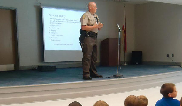 Deputy Bloom speaks to WES students about the importance of not speaking with strangers. (Contributed)