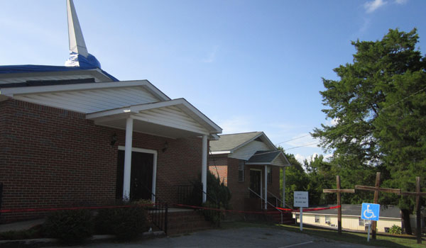 A blue tarp covers the roof and red warning tape marks the area surrounding Mt. Olive Missionary Baptist Church, where the roof collapsed on Sunday, Sept. 7. (Reporter Photo/Ginny Cooper McCarley)