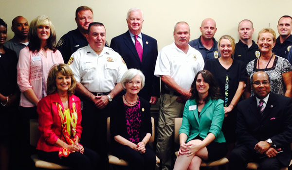 First responders pose for a photogrpah with First Lady Dianne Bentley and SafeHouse Executive Director Erin Melaney Bodden. (Reporter Photo/Ginny Cooper McCarley)