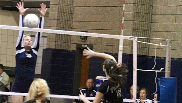 Briarwood's Lauren Palmer reaches up to block a return by Pelham's Sarah Sudd in a an Oct. 5 matchup. (Contributed/Emily Jackson)