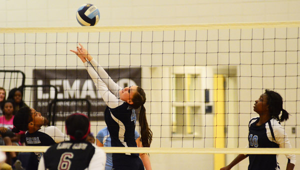 Calera's Hannah Marling twists to return a volley in a matchup with Shelby County on Oct. 16. (Reporter Photo/Drew Granthum)