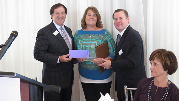 From left. AHF Executive Director Armand DeKeyser, Irvin and AHF Board Chairman Guin Robinson, (Contributed)