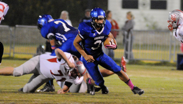 Kingwood's Chase Inabinett looks for extra yardage in an Oct. 24 matchup with Coosa Valley. The Lioins took the contest, 51-8. (Contributed/Diane Cunningham)