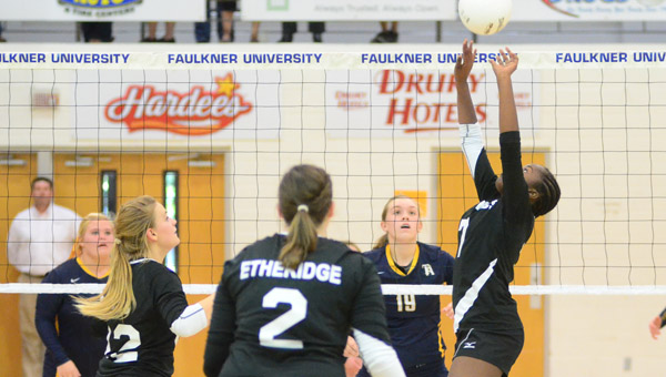 Kingwood's Kristen Boyd sets a ball in the AISA State Championship Oct. 23. (Reporter Photo/Drew Granthum)