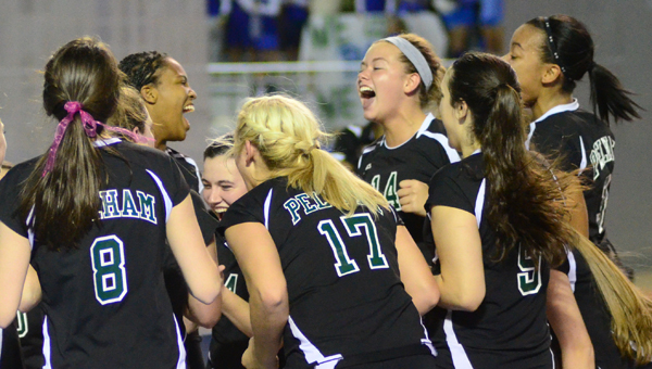 Members of Pelham's volleyball team celebrate after scoring a crucial point in a win over Arab on Oct. 30. With the win, the Panthers move to the finals of the AHSAA Class 6A State Volleyball Championship Match. (Reporter Photo/Drew Granthum)