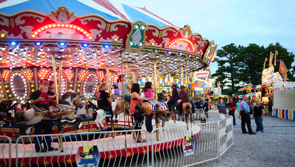 Families enjoy the many attractions available at the Shelby County Fair. (Reporter Photo/Jon Goering)