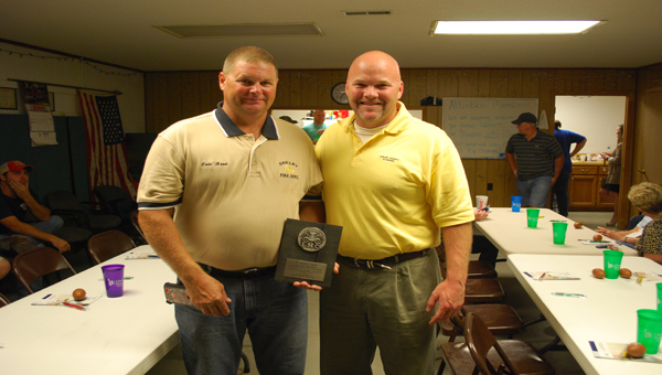 Cain Reed, pictured left, was awarded the Liberty Mutual Firemark Award Thursday, Oct. 2 and is now eligible for a National Firemark Award later in the year. (Reporter Photo/Graham Brooks)