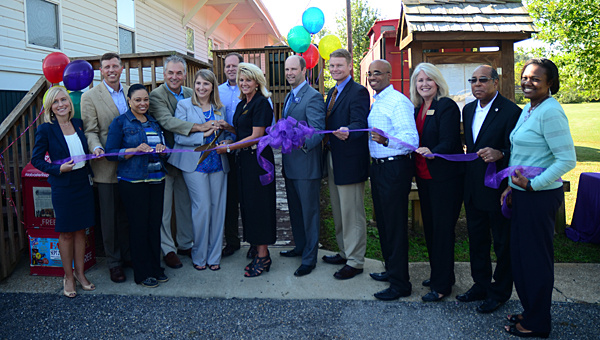 Alabaster, Shelby County and Big Brothers Big Sisters of Central Alabama representatives celebrate the grand opening of the agency's new location in Alabaster. (Reporter Photo/Neal Wagner)