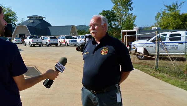 Pelham Fire Department Chief Danny Ray discusses the progress of the search for a missing diver in front of Dive Alabama on Oct. 9. (Reporter Photo / Molly Davidson)